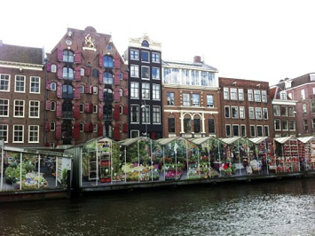 Visit the floating Flower Market