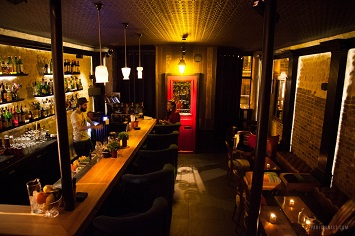 Have your cocktail at the Little Red Door